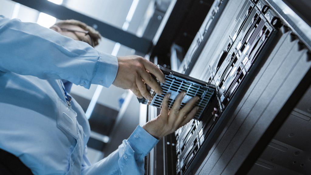 IT engineer installing hard drive