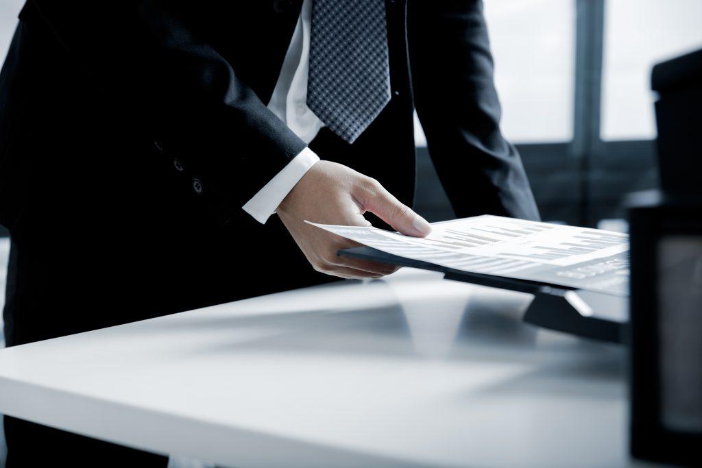 businessman using a printer