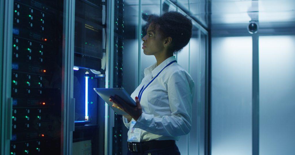 female IT engineer working on server rack
