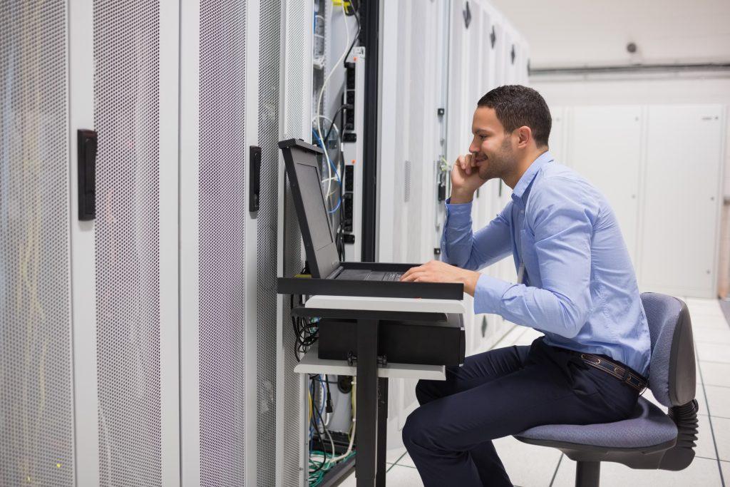 engineer maintaining server in data center