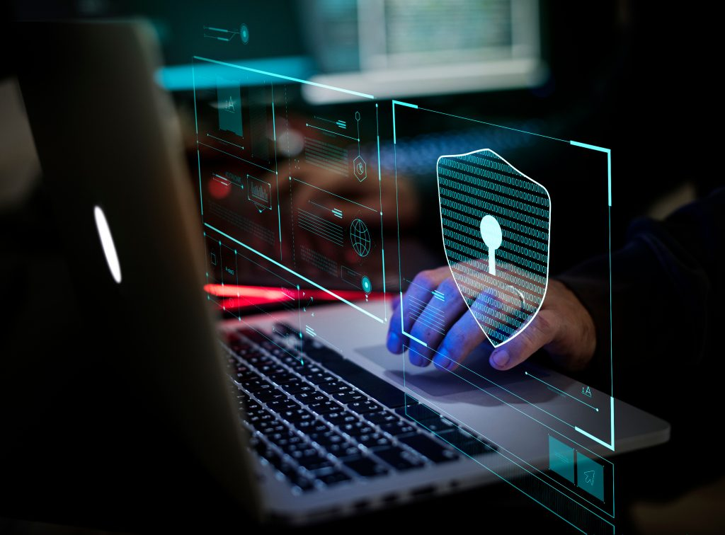 digital crime being committed on a laptop by hacker