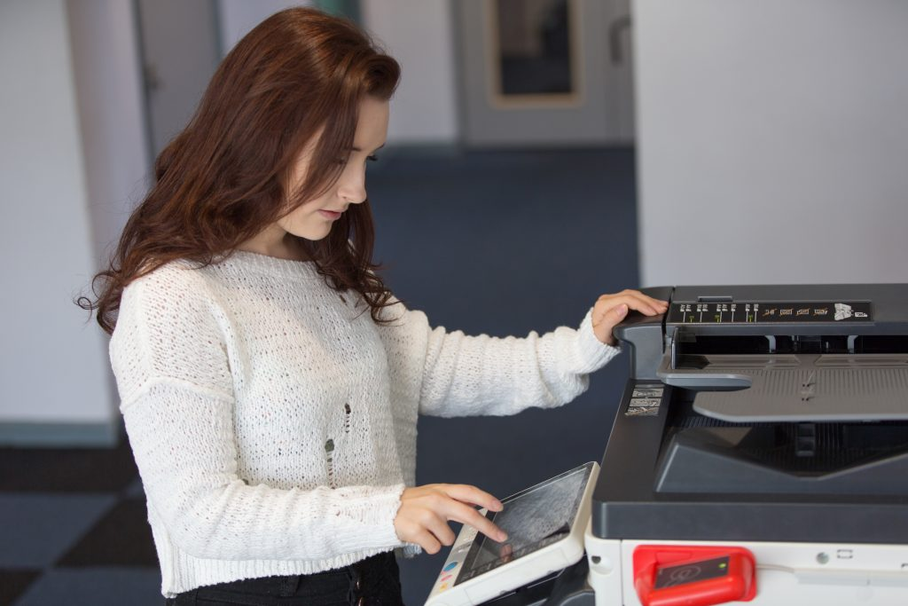 female college student using printer