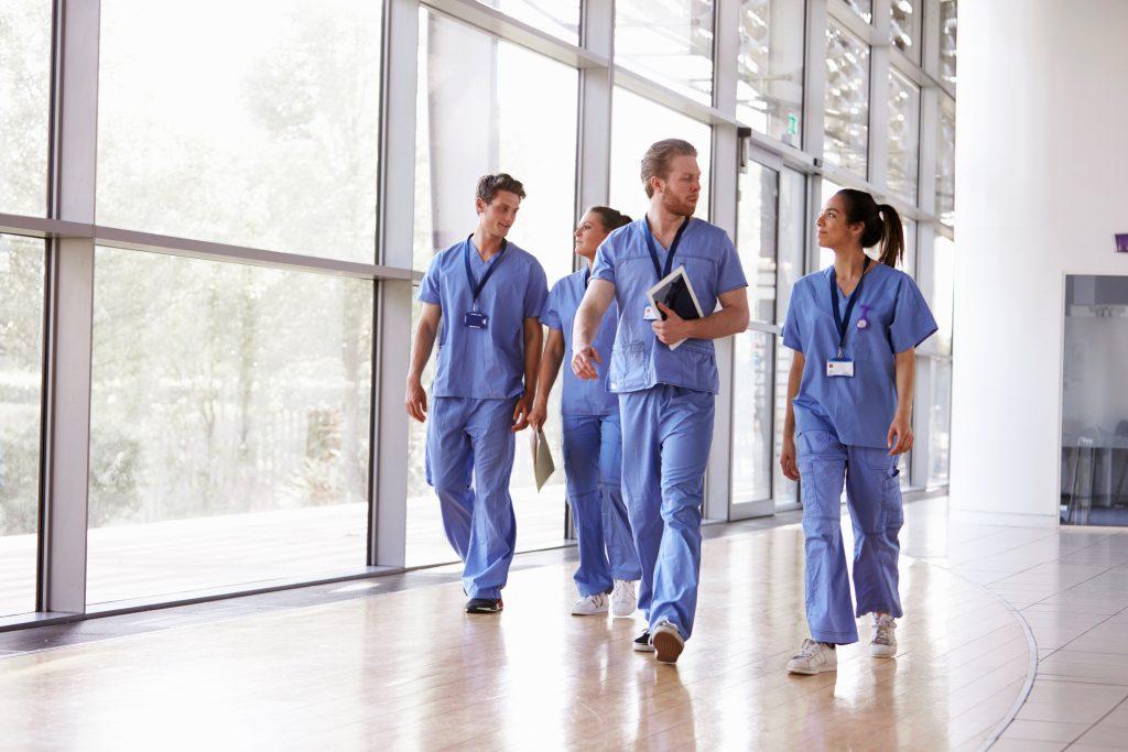 group of nurses walking through a hospital